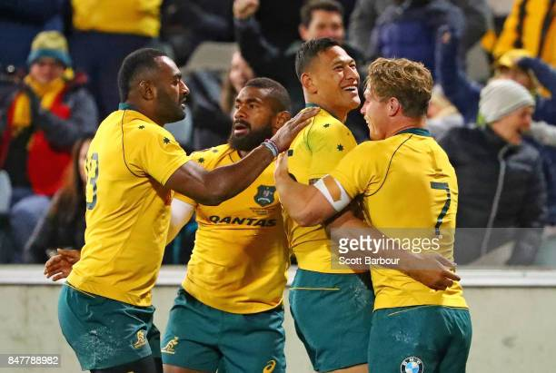 Israel Folau of the Wallabies is congratulated by Michael Hooper and his teammates after scoring a try during The Rugby Championship match between...