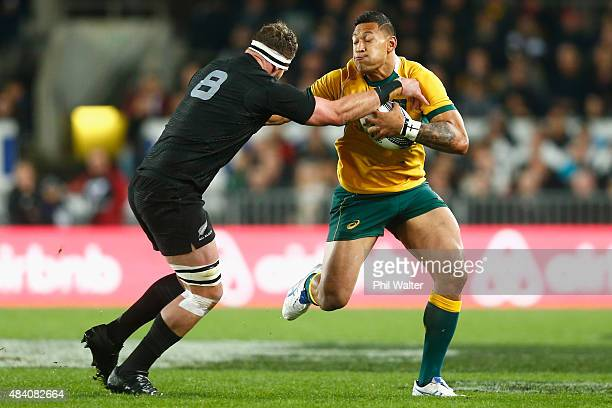 Israel Folau of the Wallabies is tackled by Kieran Read of the All Blacks during The Rugby Championship Bledisloe Cup match between the New Zealand...