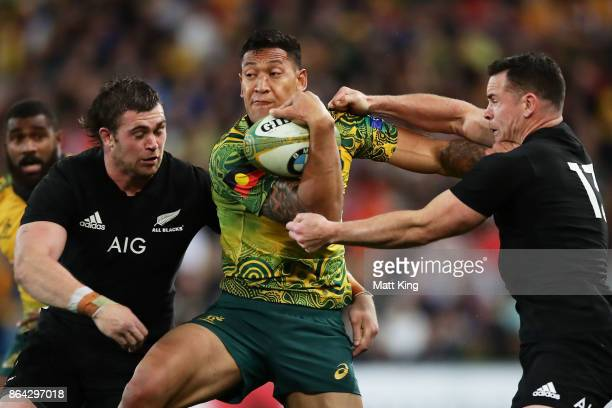 Israel Folau of the Wallabies is tackled by Ryan Crotty of the All Blacks during the Bledisloe Cup match between the Australian Wallabies and the New...