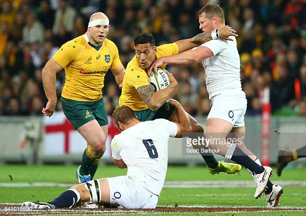 Israel Folau of the Wallabies is tackled during the International Test match between the Australian Wallabies and England at AAMI Park on June 18...