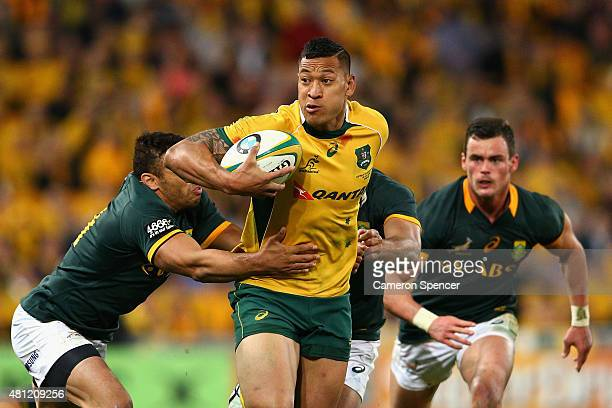 Israel Folau of the Wallabies is tackled during The Rugby Championship match between the Australian Wallabies and the South Africa Springboks at...