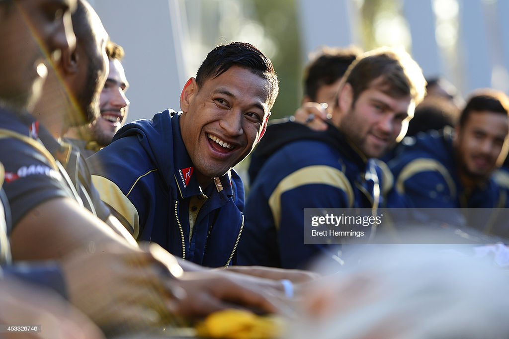 <a gi-track='captionPersonalityLinkClicked' href=/galleries/search?phrase=Israel+Folau&family=editorial&specificpeople=4194699 ng-click='$event.stopPropagation()'>Israel Folau</a> of the Wallabies laughs with team mates during an Australian Wallabies fan day event at The Mondo on August 8, 2014 in Penrith, Australia.