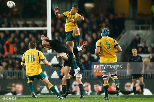 Israel Folau of the Wallabies leaps over Conrad Smith of the All Blacks during The Rugby Championship Bledisloe Cup match between the New Zealand All...