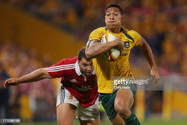 Israel Folau of the Wallabies makes a break to score a try during the First Test match between the Australian Wallabies and the British Irish Lions...