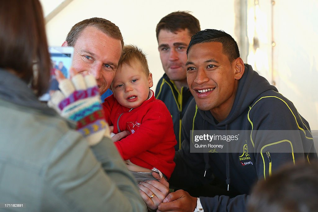 <a gi-track='captionPersonalityLinkClicked' href=/galleries/search?phrase=Israel+Folau&family=editorial&specificpeople=4194699 ng-click='$event.stopPropagation()'>Israel Folau</a> of the Wallabies poses for photos with fans during an Australian Wallabies fan day on June 23, 2013 in Melbourne, Australia.
