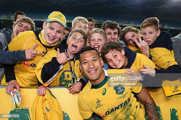 Israel Folau of the Wallabies poses with fans after winning the Rugby Championship match between the Australia Wallabies and the New Zealand All...