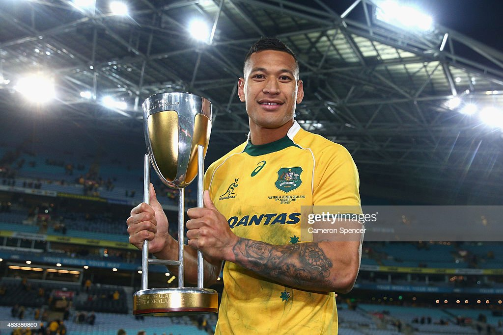 Israel Folau of the Wallabies poses with the Rugby Championship Trophy after winning the Rugby Championship match between the Australia Wallabies and the New Zealand All Blacks at ANZ Stadium on August 8, 2015 in Sydney, Australia.