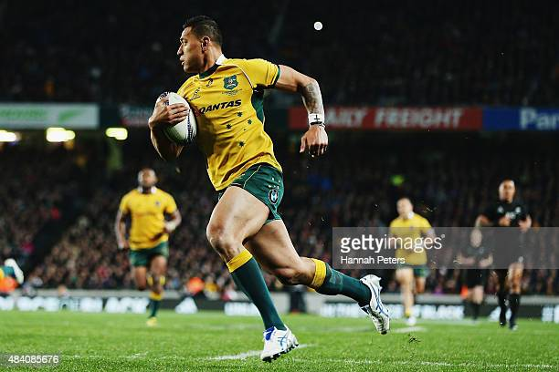 Israel Folau of the Wallabies runs in to score a try during The Rugby Championship Bledisloe Cup match between the New Zealand All Blacks and the...