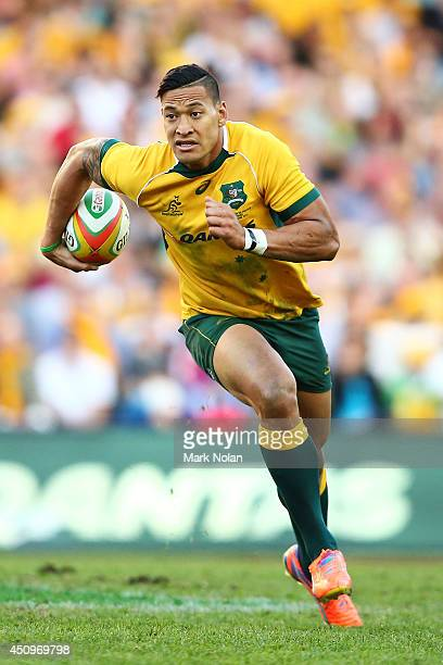 Israel Folau of the Wallabies runs the ball during the International Test match between the Australia Wallabies and France at Allianz Stadium on June...