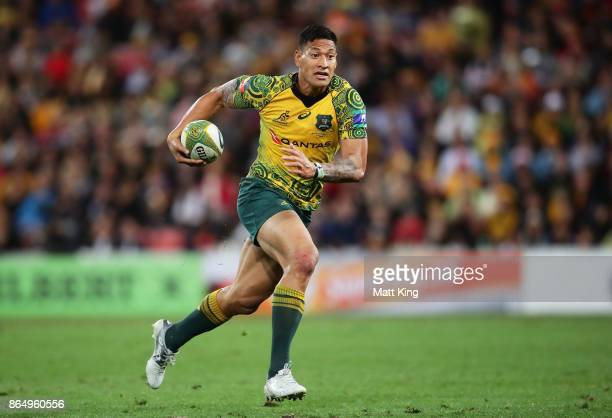 Israel Folau of the Wallabies runs with the ball during the Bledisloe Cup match between the Australian Wallabies and the New Zealand All Blacks at...
