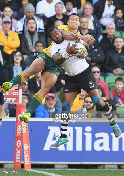 Israel Folau of the Wallabies scores a try after this contest against Kini Murimurivalu of Fiji during the International Test match between the...
