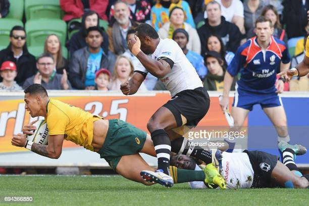 Israel Folau of the Wallabies scores a try during the International Test match between the Australian Wallabies and Fiji at AAMI Park on June 10 2017...