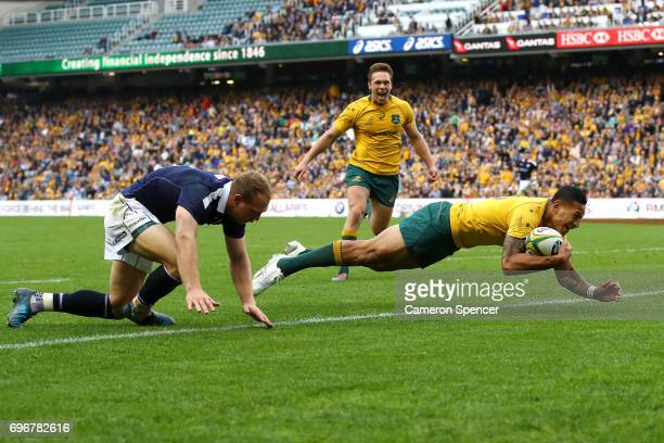 Israel Folau of the Wallabies scores a try during the International Test match between the Australian Wallabies and Scotland at Allianz Stadium on...