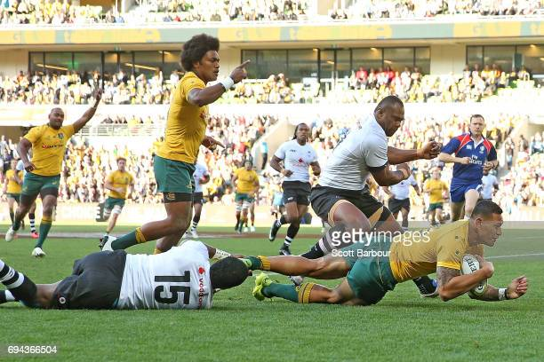 Israel Folau of the Wallabies scores the first try of the match during the International Test match between the Australian Wallabies and Fiji at AAMI...