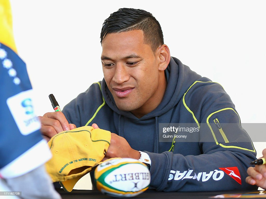 <a gi-track='captionPersonalityLinkClicked' href=/galleries/search?phrase=Israel+Folau&family=editorial&specificpeople=4194699 ng-click='$event.stopPropagation()'>Israel Folau</a> of the Wallabies signs autographs during an Australian Wallabies fan day on June 23, 2013 in Melbourne, Australia.
