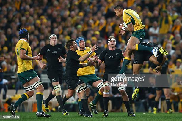 Israel Folau of the Wallabies takes the ball over Julian Savea of the All Blacks during The Rugby Championship match between the Australia Wallabies...