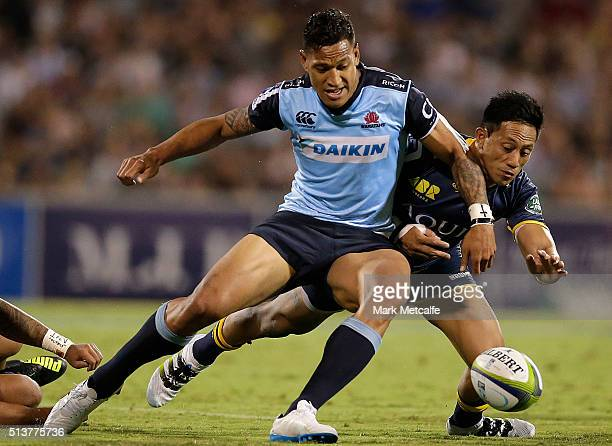 Israel Folau of the Waratahs and Christian Lealiifano of the Brumbies compete for the ball during the round two NRL match between the Brumbies and...