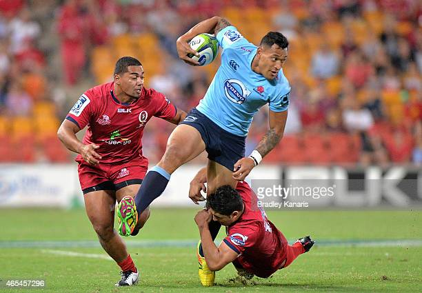Israel Folau of the Waratahs attemtps to break through the defence during the round 4 Super Rugby match between the Queensland Reds and the New South...