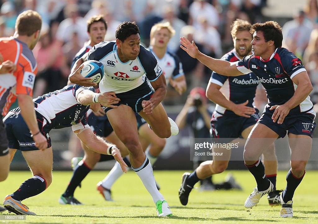 Israel Folau of the Waratahs breaks through the Rebels defence to score the first try of the game during the Super Rugby trial match between the Waratahs and the Rebels at North Hobart Stadium on February 2, 2013 in Hobart, Australia.