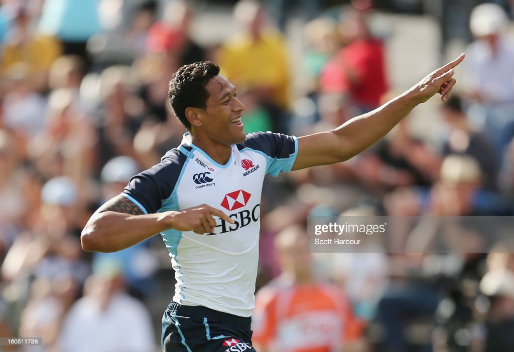 <a gi-track='captionPersonalityLinkClicked' href=/galleries/search?phrase=Israel+Folau&family=editorial&specificpeople=4194699 ng-click='$event.stopPropagation()'>Israel Folau</a> of the Waratahs celebrates after scoring the first try of the game during the Super Rugby trial match between the Waratahs and the Rebels at North Hobart Stadium on February 2, 2013 in Hobart, Australia.