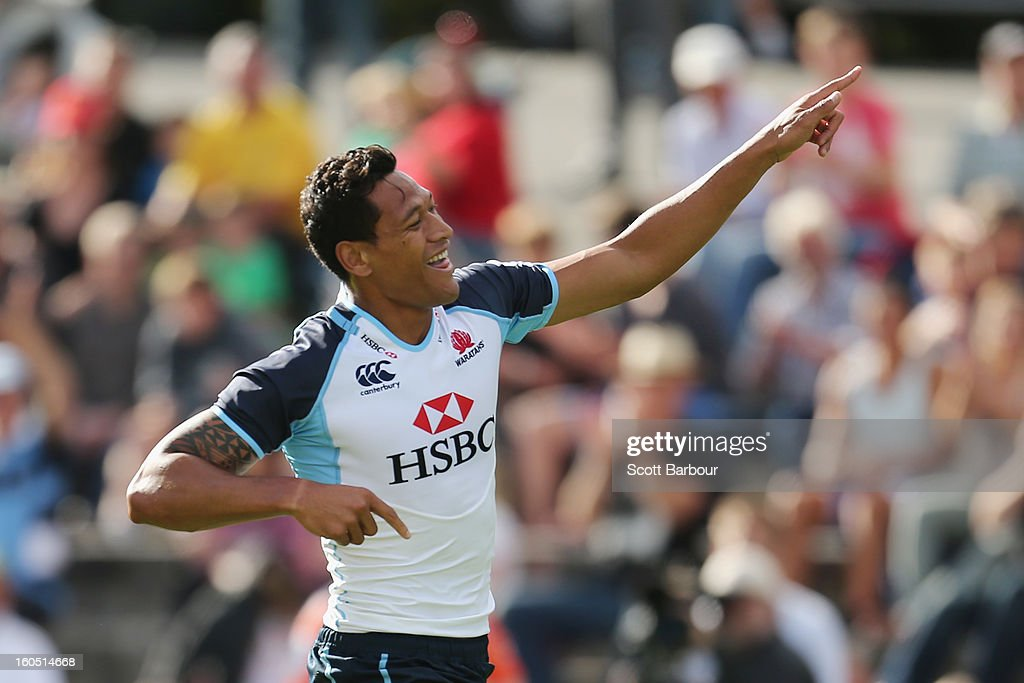 Israel Folau of the Waratahs celebrates after scoring the first try of the game during the Super Rugby trial match between the Waratahs and the Rebels at North Hobart Stadium on February 2, 2013 in Hobart, Australia.