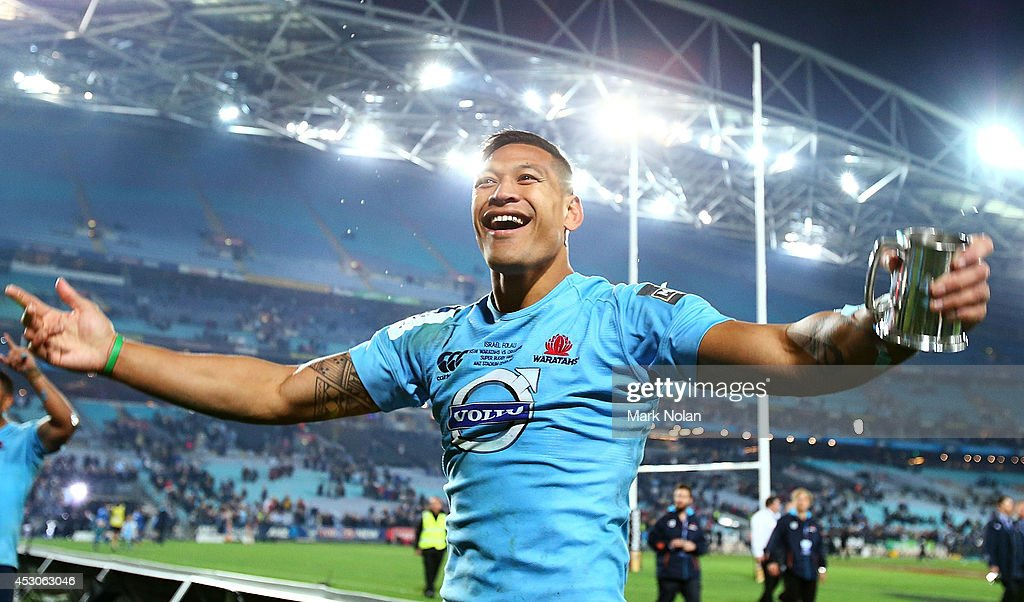 Israel Folau of the Waratahs celebrates after winning the Super Rugby Grand Final match between the Waratahs and the Crusaders at ANZ Stadium on...
