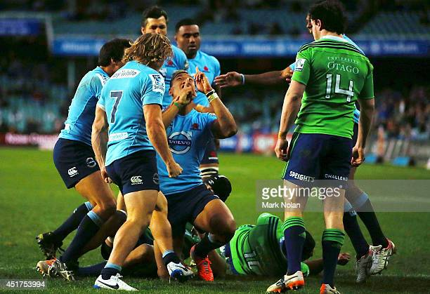 Israel Folau of the Waratahs celebrates scoring a try during the round 18 Super Rugby match between the Waratahs and the Highlanders at Allianz...