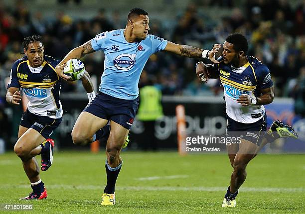 Israel Folau of the Waratahs fends off Henry Speight of the Brumbies during the round 12 Super Rugby match between the Brumbies and the Waratahs at...