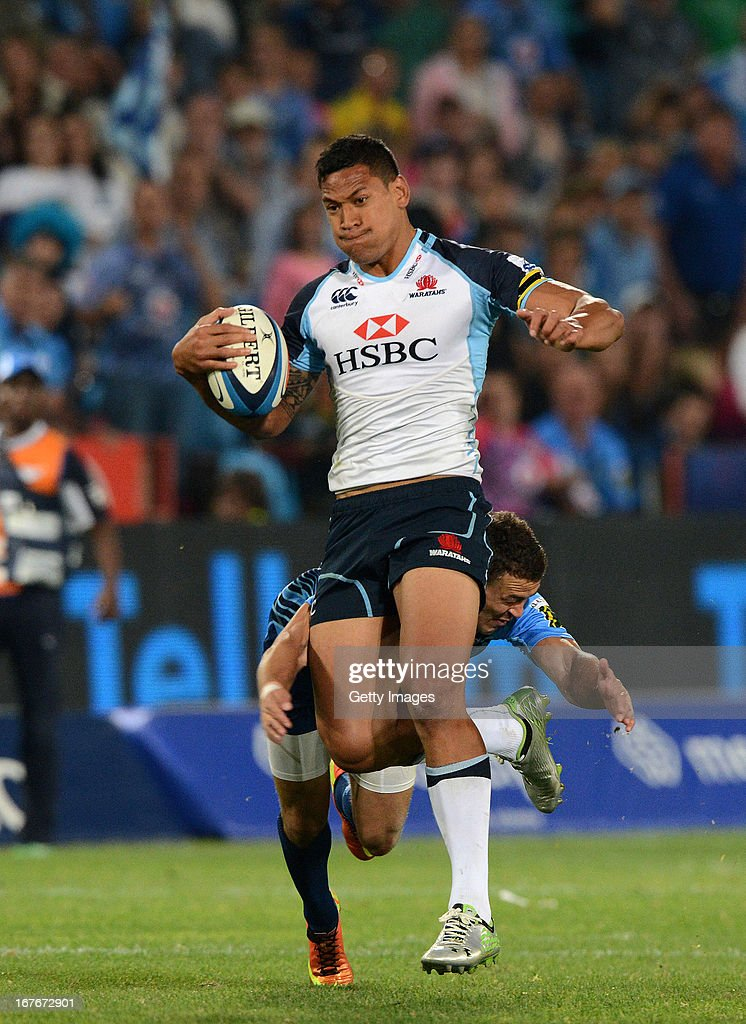 Israel Folau of the Waratahs gets tackled by Bjorn Basson of the Bulls during the Super Rugby match between Vodacom Bulls and Waratahs at Loftus Versveld on April 27, 2013 in Pretoria, South Africa.