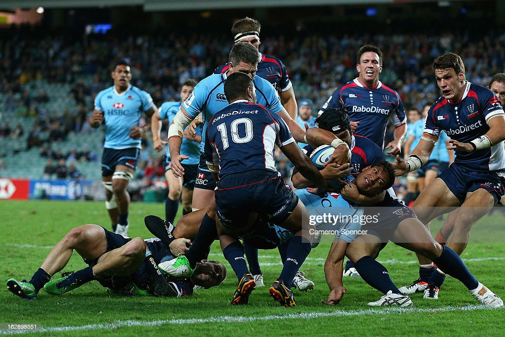 Israel Folau of the Waratahs is held up before the tryline during the round three Super Rugby match between the Waratahs and the Rebels at Allianz Stadium on March 1, 2013 in Sydney, Australia.