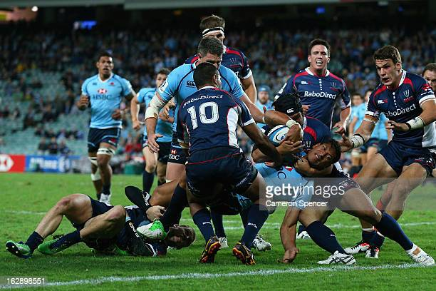Israel Folau of the Waratahs is held up before the tryline during the round three Super Rugby match between the Waratahs and the Rebels at Allianz...