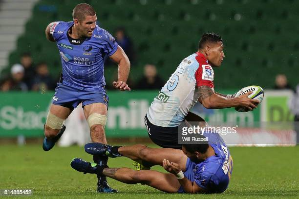 Israel Folau of the Waratahs is tackled by Curtis Rona of the Force during the round 17 Super Rugby match between the Force and the Waratahs at nib...