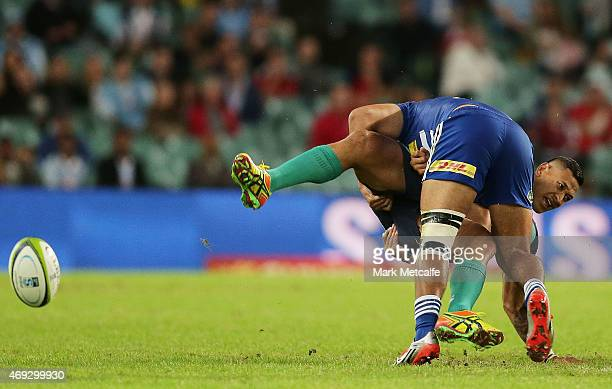 Israel Folau of the Waratahs is tackled by Damian de Allende of the Stormers during the round nine Super Rugby match between the Waratahs and the...