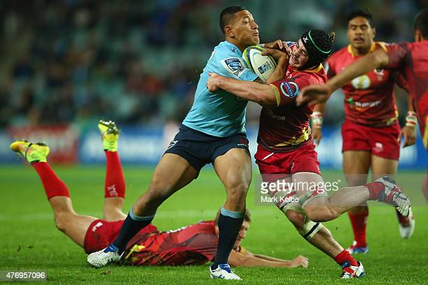 Israel Folau of the Waratahs is tackled by Liam Gill of the Reds during the round 18 Super Rugby match between the Waratahs and the Reds at Allianz...