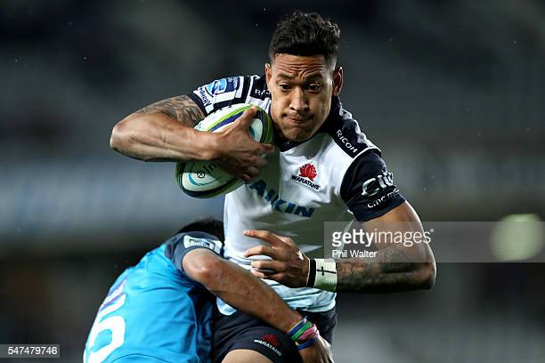 Israel Folau of the Waratahs is tackled by Melani Nanai of the Blues during the round 17 Super Rugby match between the Blues and the Waratahs at Eden...