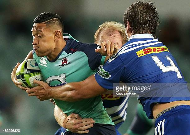 Israel Folau of the Waratahs is tackled by Schalk Burger and Eben Etzebeth of the Stormers during the round nine Super Rugby match between the...