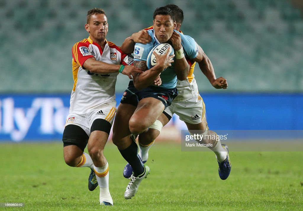 <a gi-track='captionPersonalityLinkClicked' href=/galleries/search?phrase=Israel+Folau&family=editorial&specificpeople=4194699 ng-click='$event.stopPropagation()'>Israel Folau</a> of the Waratahs is tackled during the round 10 Super Rugby match between the Waratahs and the Chiefs at Allianz Stadium on April 19, 2013 in Sydney, Australia.