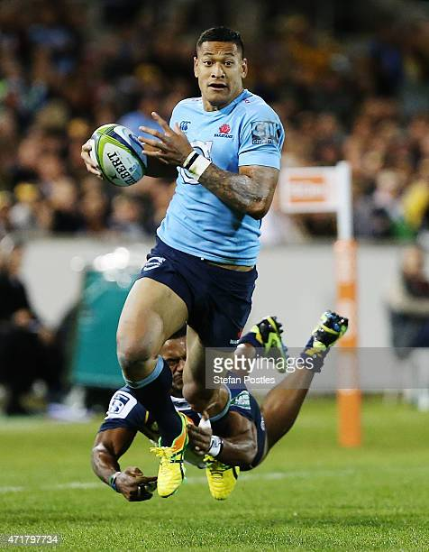 Israel Folau of the Waratahs is tackled during the round 12 Super Rugby match between the Brumbies and the Waratahs at GIO Stadium on May 1 2015 in...