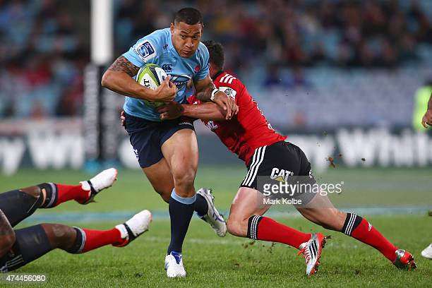 Israel Folau of the Waratahs is tackled during the round 15 Super Rugby match between the Waratahs and the Crusaders at ANZ Stadium on May 23 2015 in...