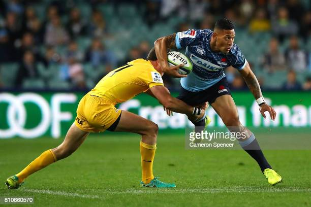 Israel Folau of the Waratahs is tackled during the round 16 Super Rugby match between the Waratahs and the Jaguares at Allianz Stadium on July 8 2017...