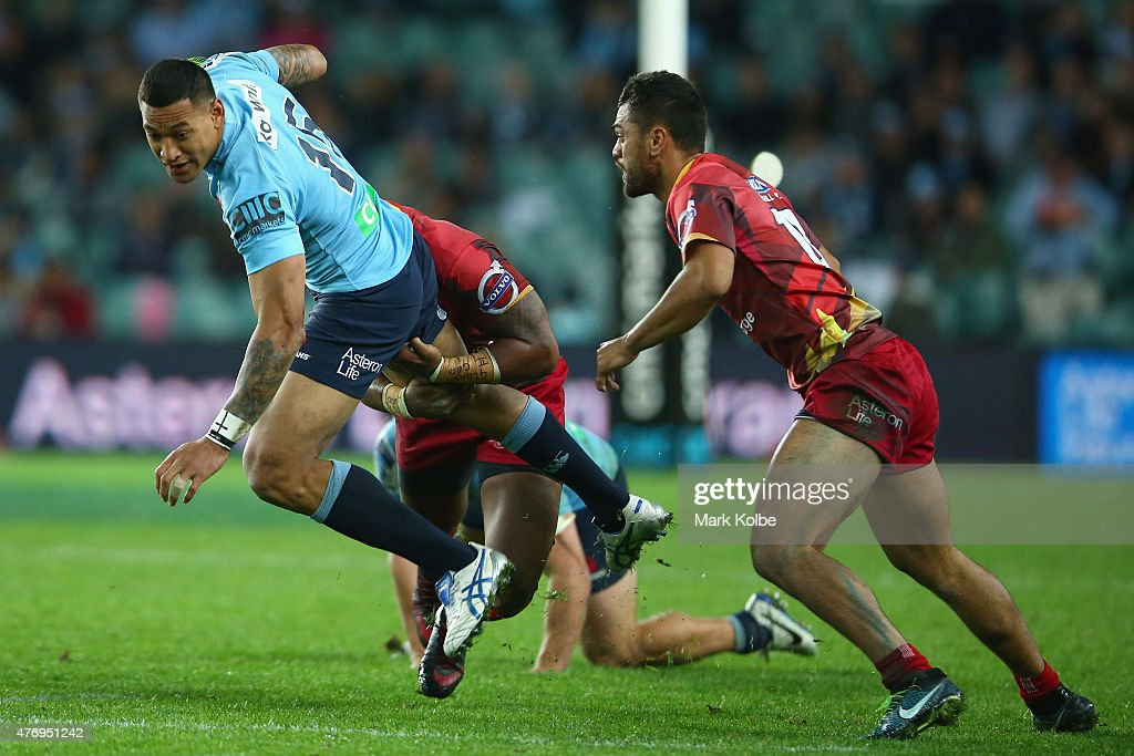 Israel Folau of the Waratahs is tackled during the round 18 Super Rugby match between the Waratahs and the Reds at Allianz Stadium on June 13 2015 in...