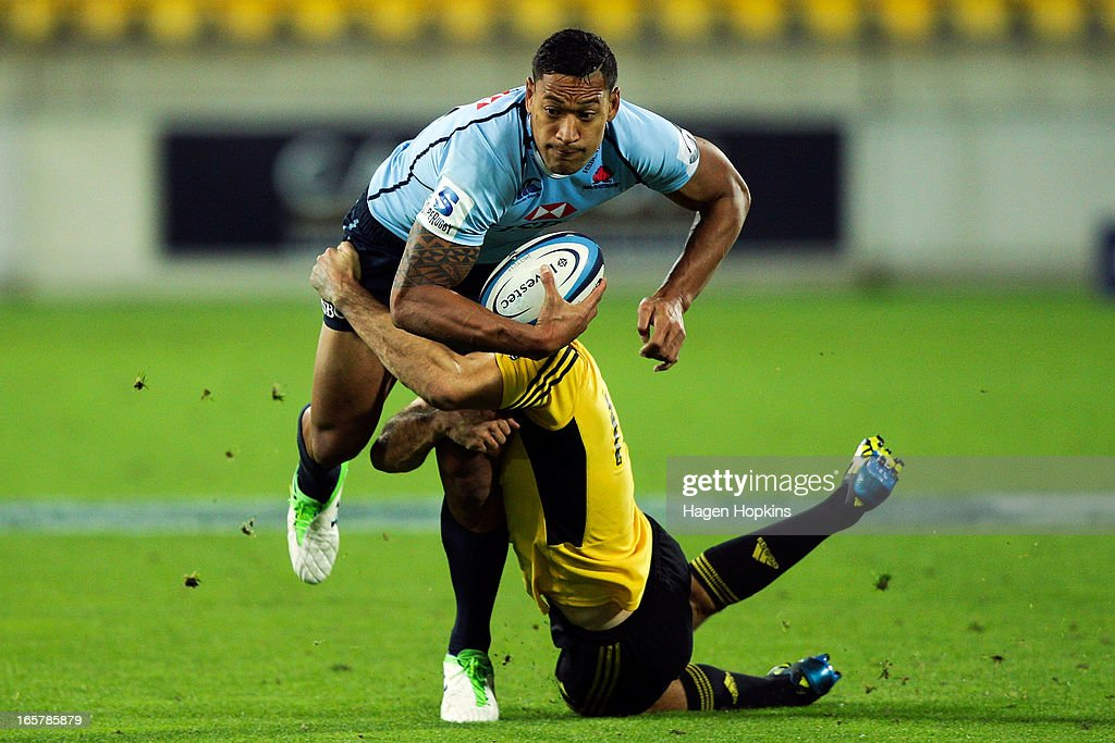 <a gi-track='captionPersonalityLinkClicked' href=/galleries/search?phrase=Israel+Folau&family=editorial&specificpeople=4194699 ng-click='$event.stopPropagation()'>Israel Folau</a> of the Waratahs is tackled during the round eight Super Rugby match between the Hurricanes and the Waratahs at Westpac Stadium on April 6, 2013 in Wellington, New Zealand.