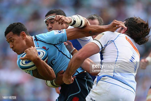 Israel Folau of the Waratahs is tackled during the round seven Super Rugby match between the Waratahs and the Force at Allianz Stadium on March 31...
