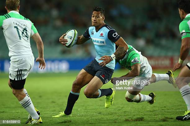Israel Folau of the Waratahs is tackled during the Super Rugby match between the New South Wales Waratahs and the Highlanders at Allianz Stadium on...