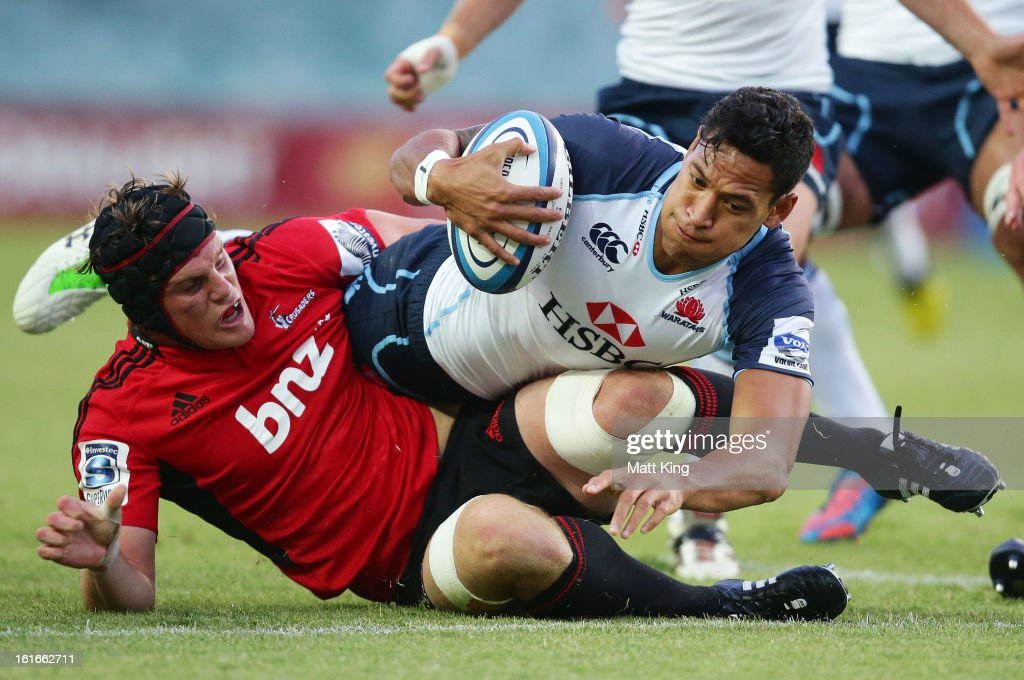 <a gi-track='captionPersonalityLinkClicked' href=/galleries/search?phrase=Israel+Folau&family=editorial&specificpeople=4194699 ng-click='$event.stopPropagation()'>Israel Folau</a> of the Waratahs is tackled during the Super Rugby trial match between the Waratahs and the Crusaders at Allianz Stadium on February 14, 2013 in Sydney, Australia.
