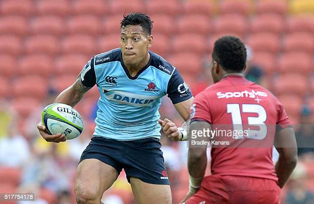 Israel Folau of the Waratahs looks to take on the defence during the round five Super Rugby match between the Reds and the Waratahs at Suncorp...