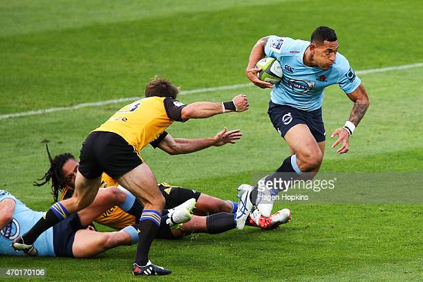 Israel Folau of the Waratahs makes a break during the round 10 Super Rugby match between the Hurricanes and the Waratahs at Westpac Stadium on April...