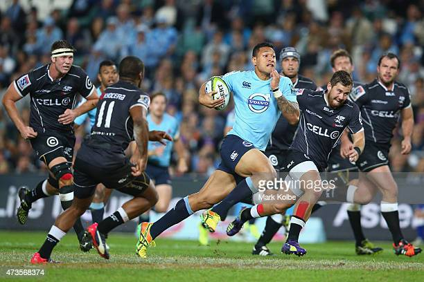 Israel Folau of the Waratahs makes a break during the round 14 Super Rugby match between the Waratahs and the Sharks at Allianz Stadium on May 16...