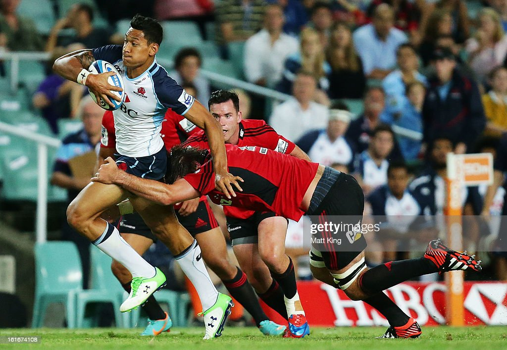 Israel Folau of the Waratahs makes a break during the Super Rugby trial match between the Waratahs and the Crusaders at Allianz Stadium on February 14, 2013 in Sydney, Australia.