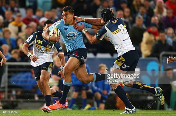 Israel Folau of the Waratahs makes a line break during the round 17 Super Rugby match between the Waratahs and the Brumbies at ANZ Stadium on June 28...